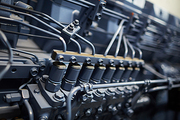 Close-up of diesel engine of mining farm machine with steel tubes and bolts, copy space