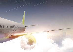 하늘 구름 위를 날고있는 비행기