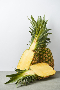 organic and sweet pineapple halves on white background