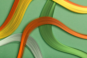 close up of multicolored bright abstract lines on green background