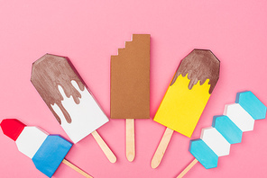 top view of handmade colorful origami ice cream isolated on pink