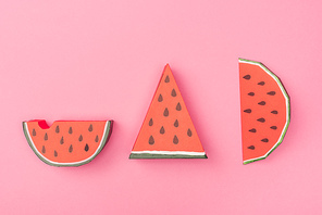 top view of handmade paper watermelon slices isolated on pink