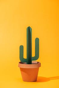 handmade green paper cactus in flower pot on orange