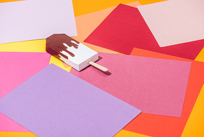 handmade origami ice cream on multicolored paper with copy space