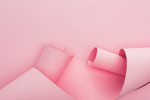 top view of pink paper swirls on pink background