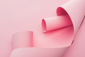 abstract pink paper swirls on pink background