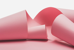 pink paper swirls with shadow isolated on white