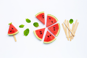 Slices of watermelon with popsicle on white background. Top view