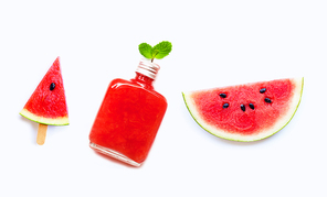 Watermelon slice and popsicle with  bottle of healthy watermelon juice isolated on white background.