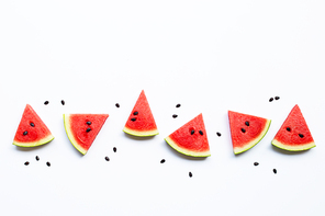 Slices of watermelon with seeds isolated on white background, top view