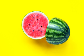 Fresh watermelon on yellow background. Top view