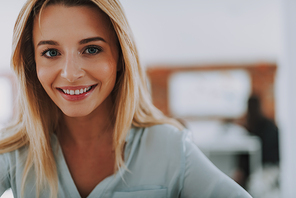 Portrait of a beautiful young smiling woman looking at the camera. Copy space on the right side